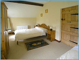 on of the bedrooms in the cottage
