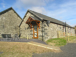 the holiday cottage and patio with views of mountains of snowdonia