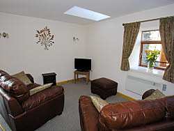 lounge of the cottage - ideal for planning days out in snowdonia